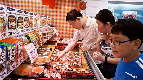 Asian Family Customers Shopping in The Super Market