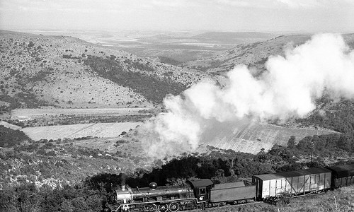 South African Railways steam locomotive class 19D No 2756 on a down mixed to Grahamstown near Goodwins Kloof, Cape Province, South Africa.